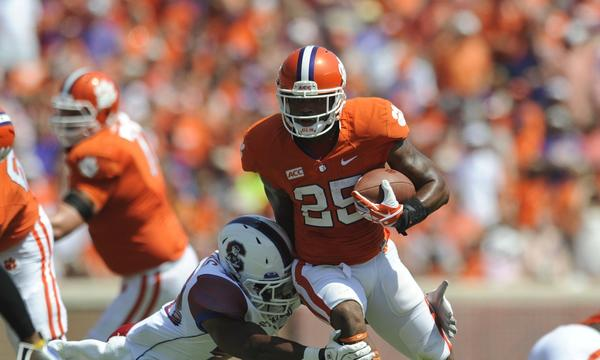 Clemson running back Roderick McDowell breaks a tackle attempt by South Carolina's Joe Thomas during the first half of the Tigers' win Saturday.