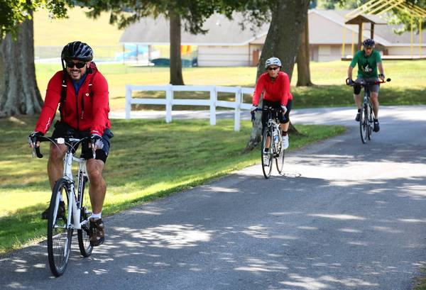 Cyclists come to a finish at the ride for remembrance of Larry Bensky, a local man who was killed as he rode his bike in rural Baltimore County.