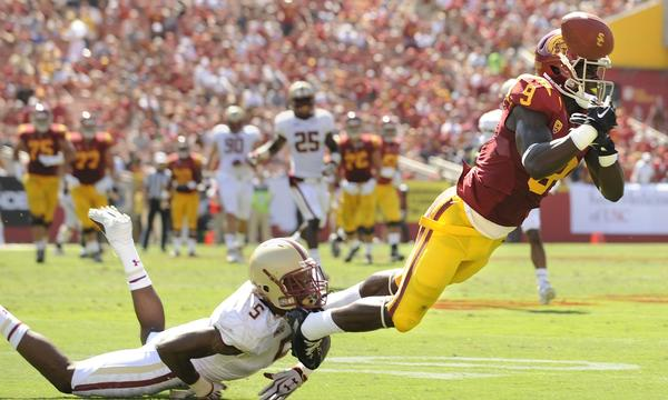 USC wide receiver Marqise Lee, right, can't haul in a pass while under pressure from Boston College's Al Louis-Jean Jr. during the Trojans' win on Saturday.