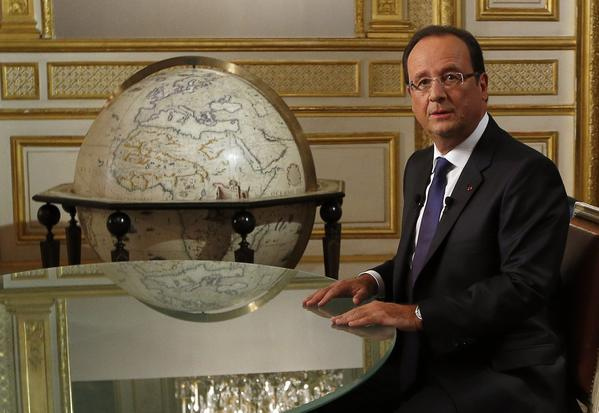 French President Francois Hollande, at the Elysee presidential palace in Paris, discussed the Syria chemical weapons deal in an interview with French television channel TF1.