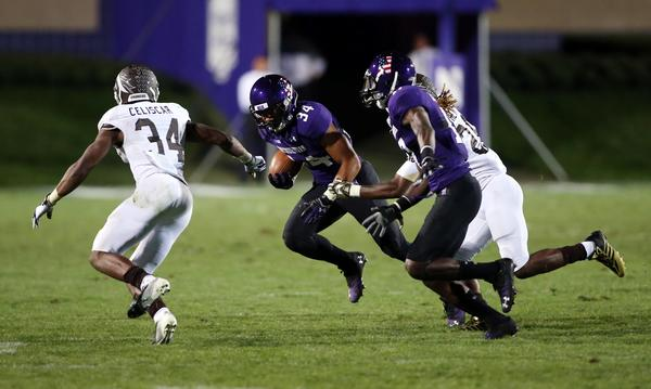 Warren Long (34) runs with the ball against Western Michigan's Donald Celiscar during the fourth quarter at Ryan Field.