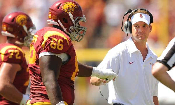 USC center Marcus Martin is congratulated by Coach Lane Kiffin after a USC touchdown against Boston College on Saturday.