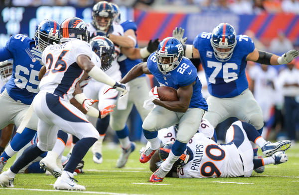 Running back David Wilson #22 of the New York Giants carries the ball during the first half against the Denver Broncos at MetLife Stadium on September 15, 2013 in East Rutherford, New Jersey.