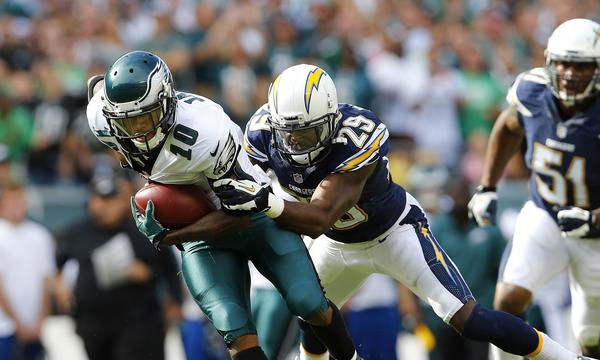 Philadelphia wide receiver DeSean Jackson, left, is taken down by San Diego cornerback Shareece Wright during the fourth quarter of the Chargers' 33-30 win Sunday.