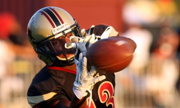 Alemany's Desean Holmes catches a pass prior to the start of Friday's game against Narbonne.