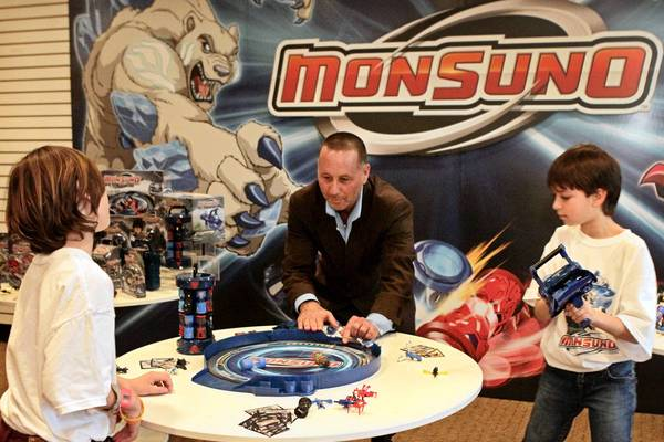 Jakks Pacific Chief Executive Stephen G. Berman plays Monsuno. a line of action figures, play sets and accessories, in the company's showroom last year with Logan Berman, 10, left, and Jesse Motavasselan, 11.
