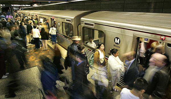 Riders crowd a platform at the 7th Street Metro Station.