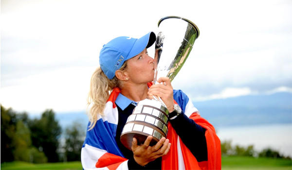 Golfer Suzann Pettersen kisses her trophy after winning the Evian Championship after shooting a three-under-par 68 at the Evian Resort Golf Club on Sunday.