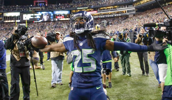 Seahawks cornerback Richard Sherman grabbed one of Seattle's three interceptions against Colin Kaepernick and the San Francisco 49ers en route to a 29-3 statement victory over their NFC West division foe.