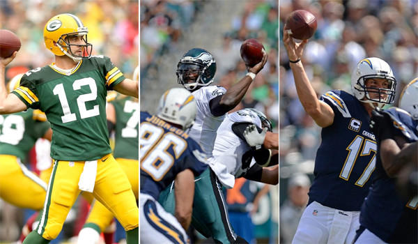 Quarterbacks Aaron Rodgers, left, Michael Vick, center, and Philip Rivers, right, all threw for more than 400 passing yards on Sunday.