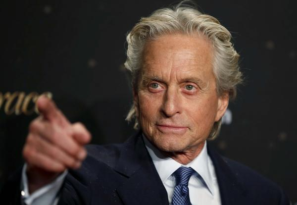 "Actor Michael Douglas arrives for the German premiere of the movie ""Behind The Candelabra"" in Berlin. The Liberace biopic scored eight awards at the 65th Annual Creative Arts Emmys."