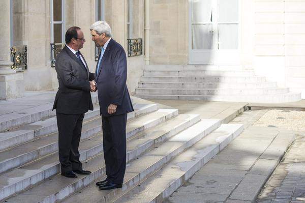 French President Francois Hollande, left, greets U.S. Secretary of State John Kerry at the presidential Elysee Palace in Paris.