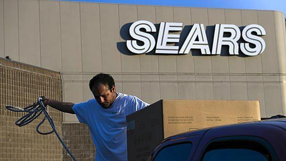 A customer secures a new washing machine purchased at a Sears store Richmond, Calif.