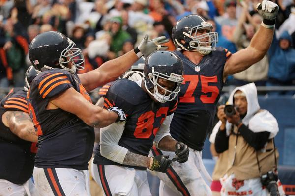 Bears tight end Martellus Bennett (83) is congratulated by teammates after catching a pass for a touchdown in the final minute against the Minnesota Vikings.