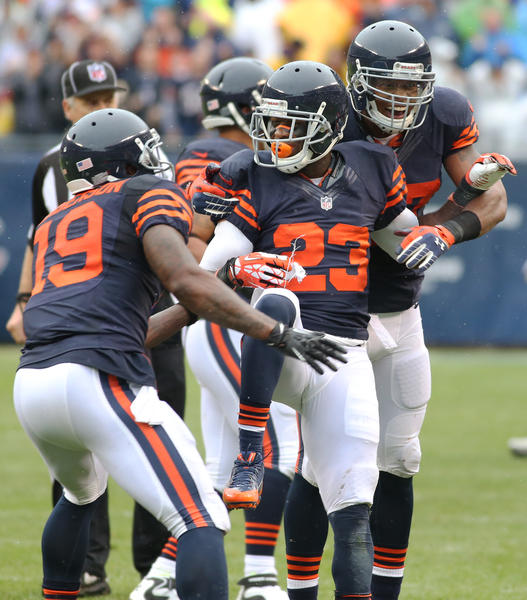 Devin Hester (23) celebrates his long kickoff return in the second quarter against the Vikings.