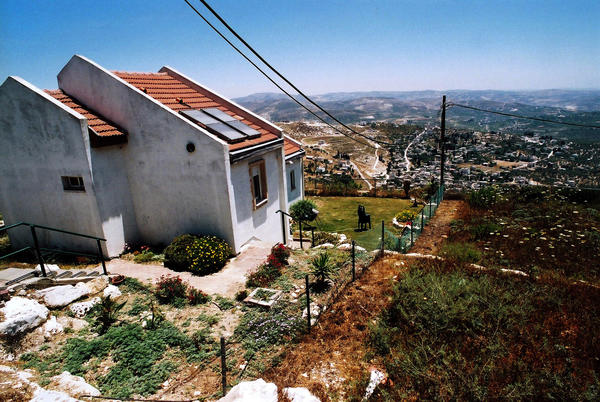 This file photo from June 9, 2005, shows a house in Homesh, a Jewish settlement in the West Bank that was ordered abandoned and returned to Palestinian control.