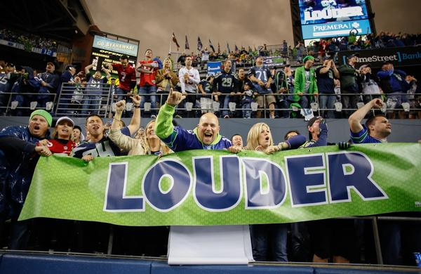 Fans cheer during Sunday's game between the Seattle Seahawks and the San Francisco 49ers at CenturyLink Field.