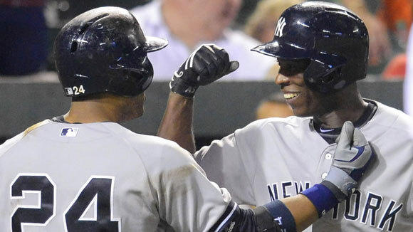 Robinson Cano, left, congratulates Alfonso Soriano on hitting the go-ahead homerun for the Yankees against the Orioles last Tuesday.