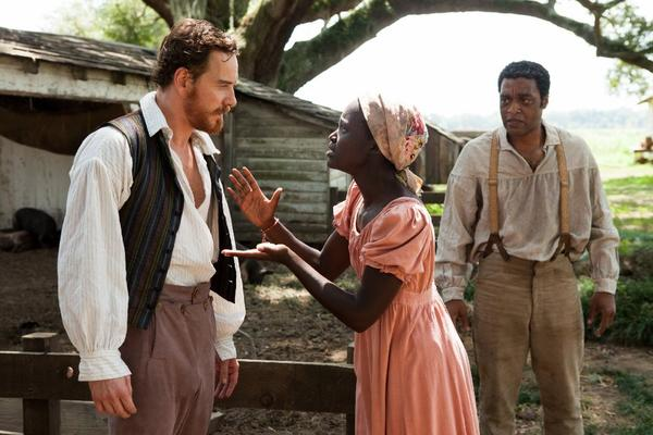 "Michael Fassbender, left, Lupita Nyong'o and Chiwetel Ejiofor in ""12 Years a Slave."""