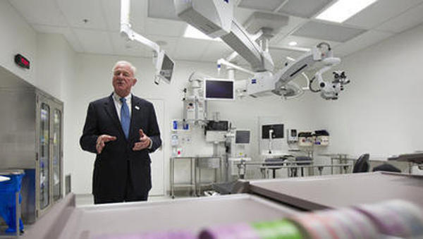 Dr. Roger Steinert, the director of the Gavin Herbert Eye Institute at UC Irvine, gives a tour of an operating room.