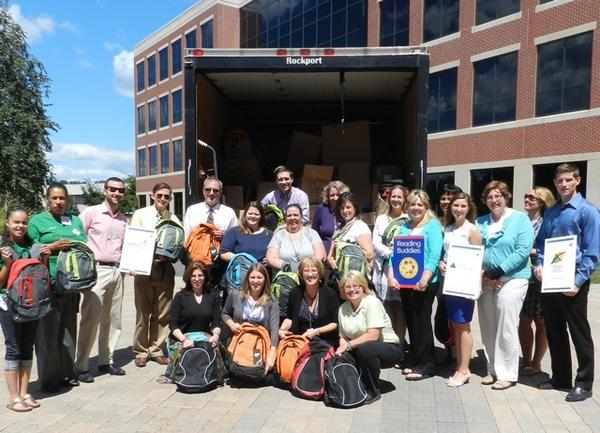 Employees from The Hartford collected and stuffed backpacks with school supplies for Gifts of Love in Avon.