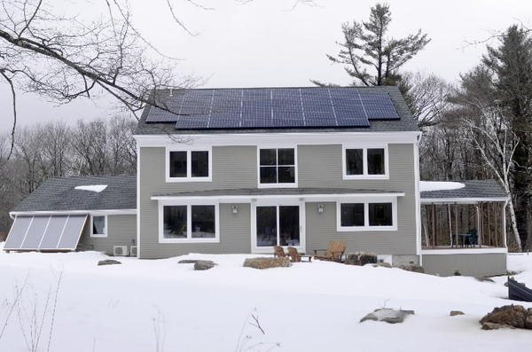 The south-facing side of Diane and Paul Honig's Harwinton home features an array of solar panels.