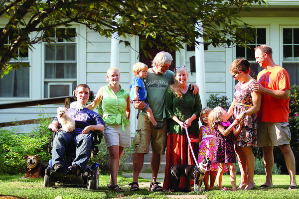 Writer Pete Pichaske shares his own perspective on sharing a home with extended family, including, from left, Peter Renzi, Diane Rashid, 2-year-old Raymond Roder, Pete and his wife, Marie Pichaske, 4-year-old Sophia Roder, 5-year-old Emma Roder, Nicole and Matt Roder.