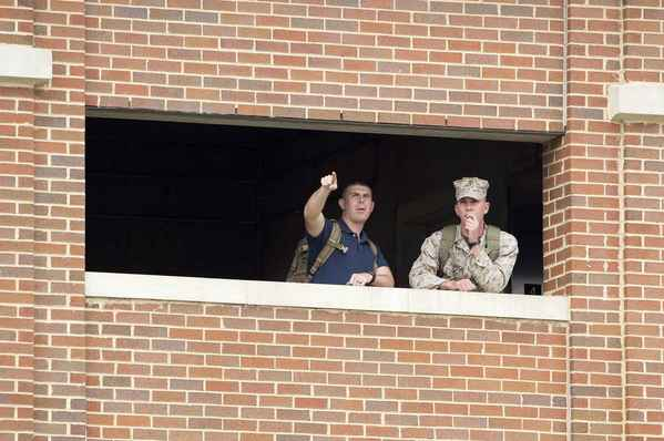 Marines watch from their barracks as police respond to a shooting by multiple gunmen at the Washington Navy Yard in Washington, Sept. 16.
