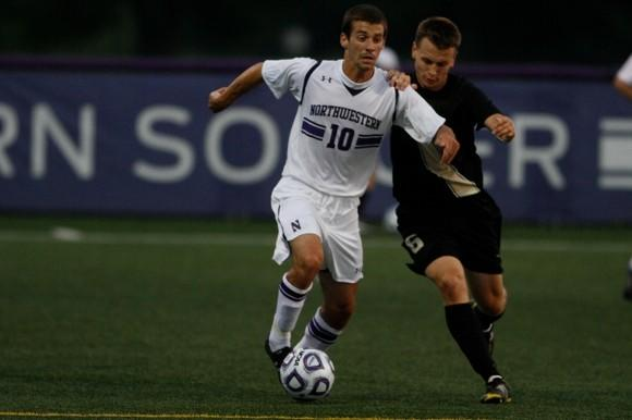 Joey Calistri dribbling against Oakland University in Northwestern's first exhibition game this season.