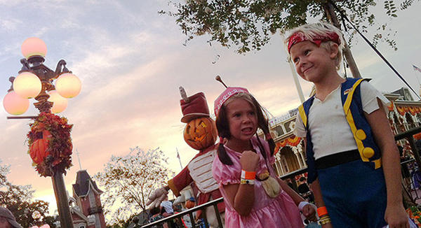 "Morgan Tribou, 6, right, and sister Miriam Tribou, 5 are dressed as Jake and Izzy from Disney Junior's ""Jake and the Neverland Pirates"" while attending Mickey's Not-So-Scary Halloween Party at Walt Disney World's Magic Kingdom on Friday, Sept. 13, 2013."