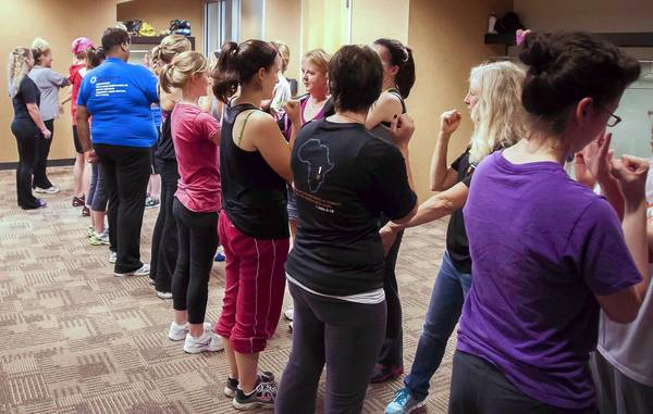 Participants learn self-defense techniques at a recent workshop in Naperville co-hosted by One Light Self Defense, a program led by two members of Parkview Christian Church in Orland Park.