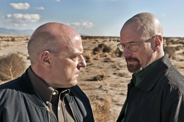 "Bryan Cranston, right, and Dean Norris costar in ""Breaking Bad,"" which hit an all-time ratings record on Sunday."