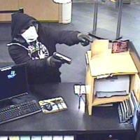 Photo from video surveillance of one of two robbers who held up a Northwest Side bank at gunpoint.