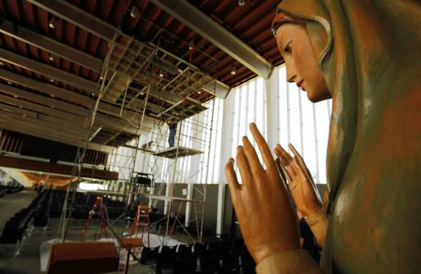 A statue of the Virgin Mary watches over the renovation underway at the Arboretum on the grounds of the former Crystal Cathedral in Garden Grove.