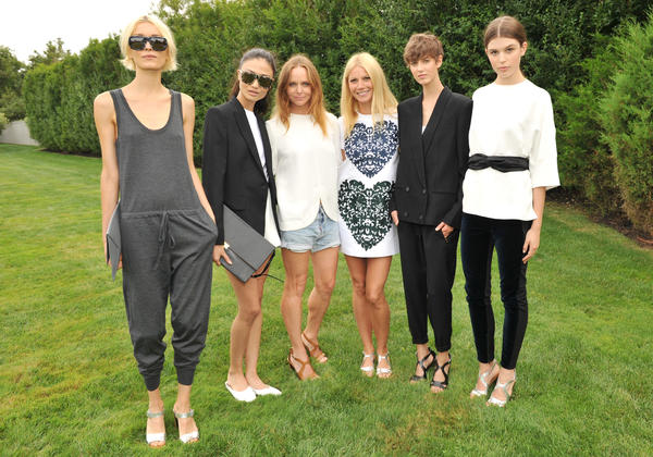 Stella McCartney, third from left, and Gwyneth Paltrow, third from right, with models wearing pieces from the Goop collection.