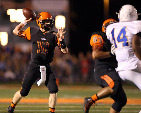 Wheaton Warrenville South quarterback Ryan Graham (10 passes against Wheaton North on Friday, Sept. 13, 2013.