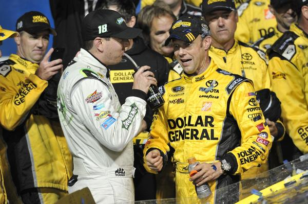 Matt Kenseth (right) celebrates in victory lane with teammate Kyle Busch (left) after winning the Geico 400 at Chicagoland Speedway.