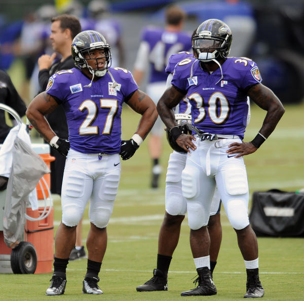 Ravens running backs Ray Rice and Bernard Pierce participate in practice during training camp.