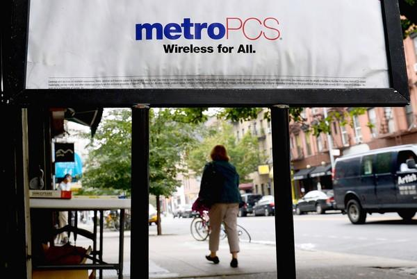 MetroPCS charges its customers a $3 fee to pay their bills in person in company stores. Above, a MetroPCS store in New York City