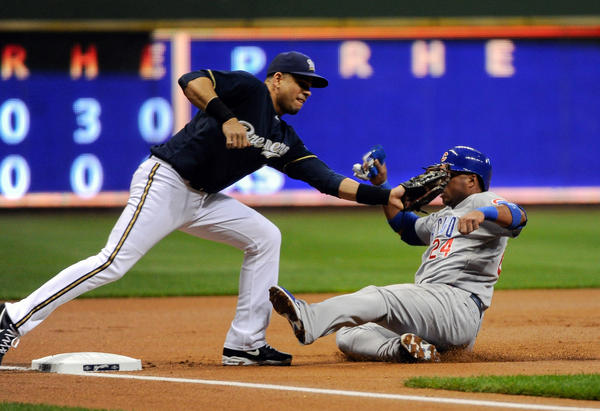 Brewers third baseman Aramis Ramirez tags out Cubs third baseman Luis Valbuena trying to steal third base.