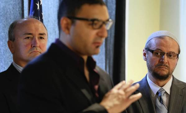 Attorney Anthony Peraica, from left, and Imam Senad Agic, right, look on as Ahmed Rehab of the Council on American-Islamic Relations announces the filing of a federal lawsuit against the city of Des Plaines.
