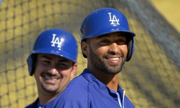 Dodgers outfielder Matt Kemp, right, smiles while taking part in batting practice with teammate Adrian Gonzalez in April. Kemp was activated off the disabled list by the Dodgers on Monday.