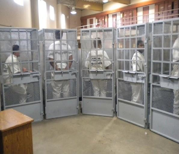 Inmates at Mule Creek State Prison are shown in this 2012 photograph held in cages for group therapy.