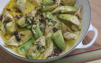 Artichokes braised with saffron, black olives and almonds