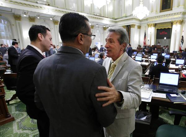 Assemblyman Tom Ammiano (D-San Franciso), right, wrote the Trust Act, which awaits action by the governor.