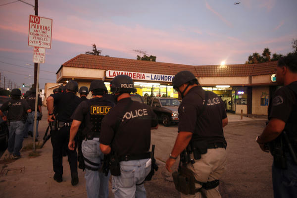 Officers ready themselves for a 2009 raid against suspected Florencia 13 gang members near South Los Angeles.