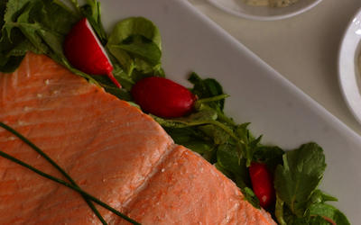 Oven-steamed wild salmon with homemade Green Goddess dressing and radish salad