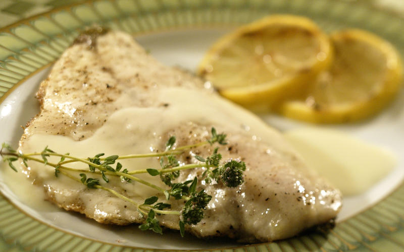 Grilled sea bass in Italian Champagne sauce (le bar grille a l'Italienne)