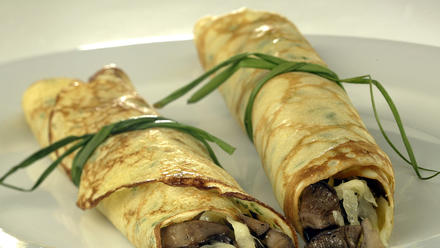 Wild mushroom crepes with cheese and chives