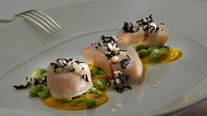 Confited yellowtail with ginger-carrot puree and warmed Asian vinaigrette
